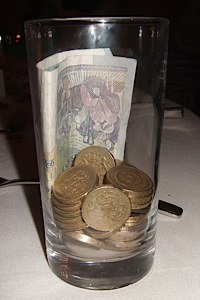 money in a glass