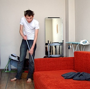 Tim cleans his flat