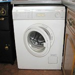 What rights does a tenant have if a property is advertised with a washing machine but then finds it does not work?